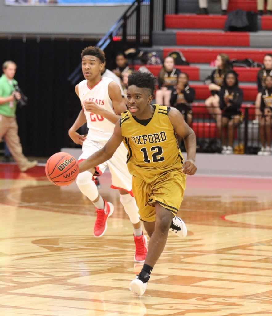 Eugene Leonard is just a freshman, but he has developed into a reliable point guard for the Oxford basketball team. On the cover, Jalen Moore (2) lunges for a steal against Saks. (Photos by Kristen Stringer/Krisp Pics Photography)