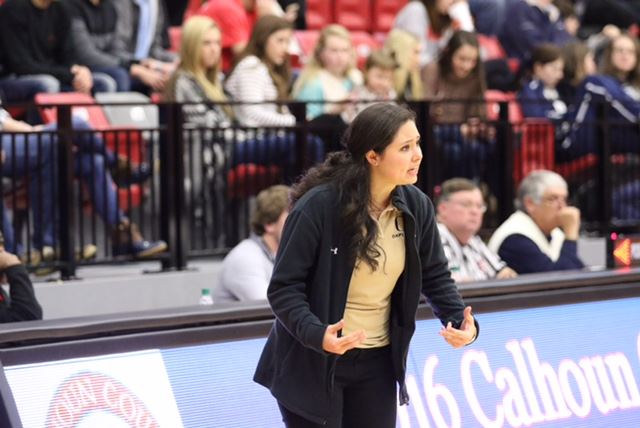 Oxford girls assistant coach Crosby Morrison tries to get her players'  attention Monday. Morrison and two other assistants ran the game with head coach Tonya Peoples out for family reasons. The Lady Jackets won a close game with Wellborn to advance in the county tournament. (Photos by Kristen Stringer/Krisp Pics Photography)