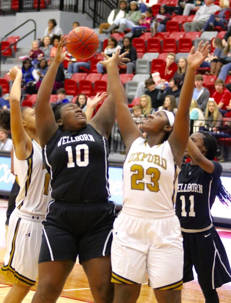 Oxford's Ebony Kelley (23) battles with Wellborn's Madison Files for a rebound during the Calhoun County Tournament. (Photos by Kristen Stringer/Krisp Pics Photography)