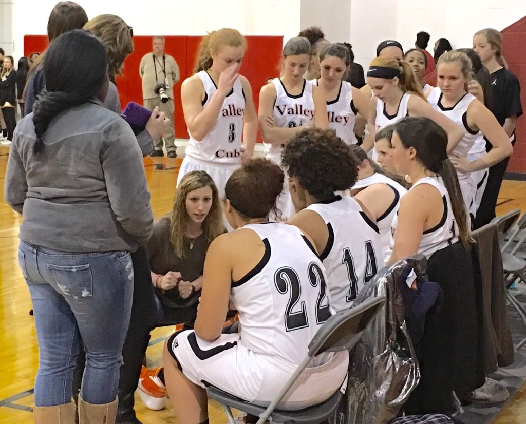 Alexandria coach Jordan Costner gives her troops instruction during a timeout Monday. The Lady Cubs came from seven down to start the fourth quarter to winning in double overtime.
