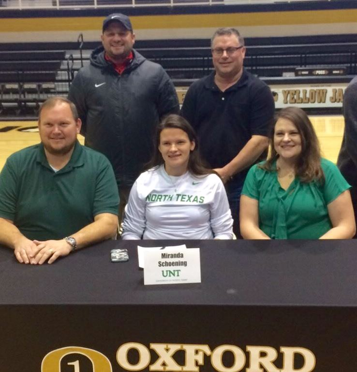 Oxford keeper Miranda Schoening is surrounded by (from left) dad Dan, Birmingham United director Andrew Brower, club coach Troy Gutterridge and mom Julie during her signing ceremony for North Texas.