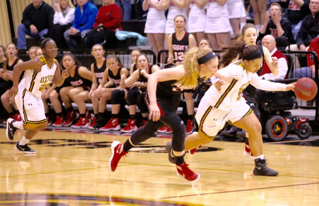 Oxford's Winter Taylor (R) races up the floor against an Albertville defender. Taylor had 13 points, six rebounds and three steals, but the Lady Yellow Jackets fell by one. (Photos by Kristen Stringer/Krisp Pics Photography)