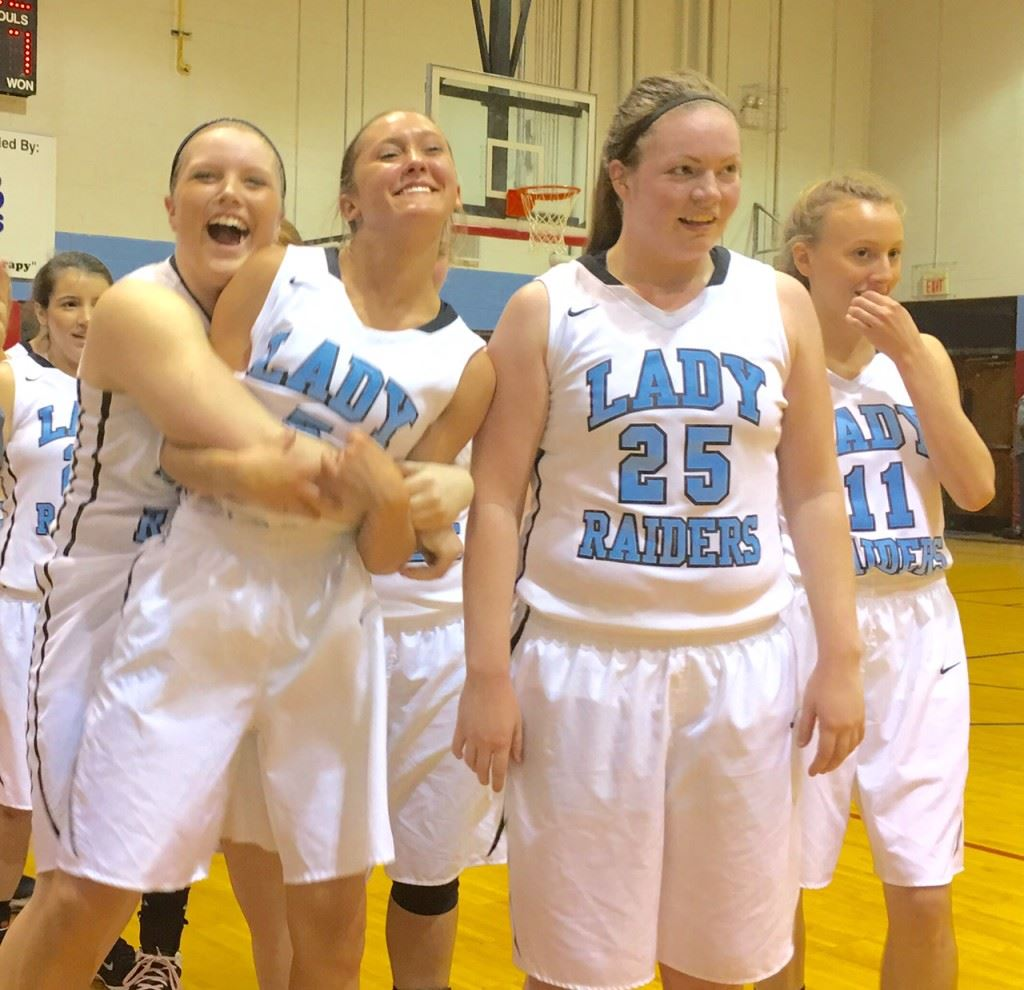 Kara Perry (L) puts a big bear hug on teammate Atleigh Brannon after Pleasant Valley clinched a spot in the 3A Northeast Regional with its fifth victory of the season over Ohatchee Monday night.