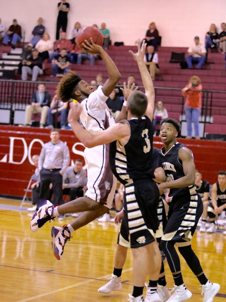 Anniston's Marrio Dobbins puts up a shot in traffic in Tuesday night's subregional game with Hayden. (Photo by Kristen Stringer/Krisp Pics Photography)