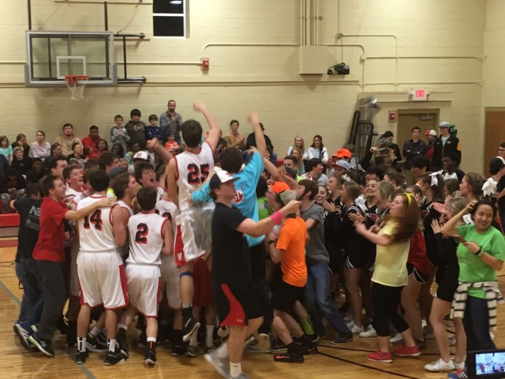 Westbrook Christian players and fans rush the floor after the Warriors defeated Weaver Tuesday to earn a trip to the Northeast Regionals.