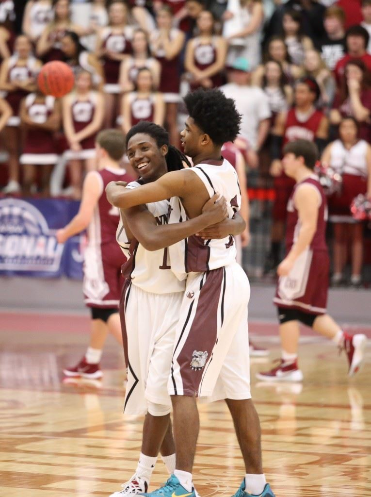 Hakeem Ross (L) and Willie Thomas celebrate Friday's regional semifinal victory that gives Schuessler Ware (below) another game to coach. (Photos by Kristen Stringer/Krisp Pics Photography)