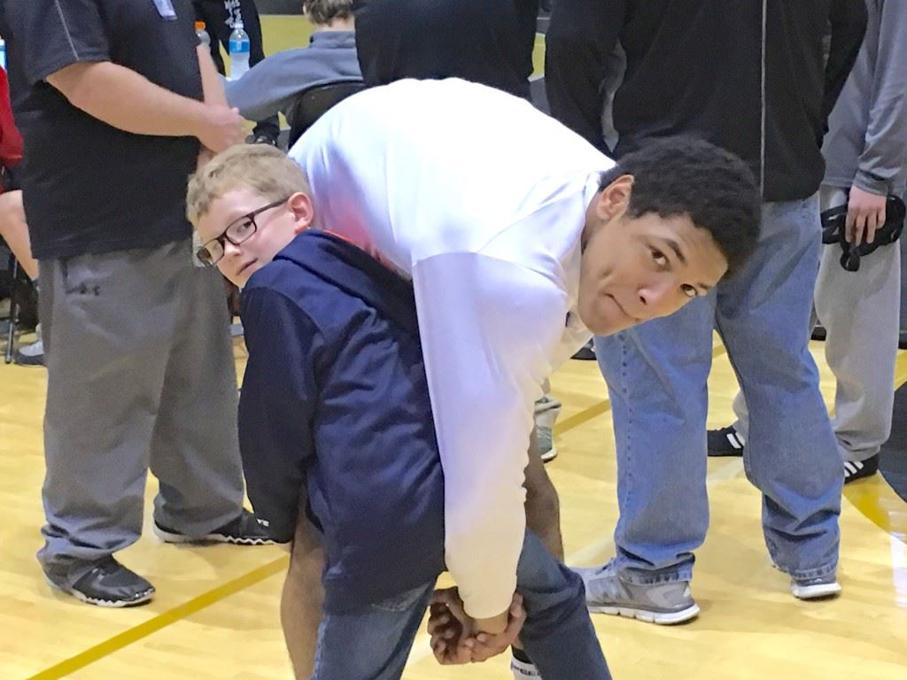 Alexandria freshman Christian Knop, the school's first wrestling state champion, has some fun with Hayden Hartzog, the son of Valley Cubs coach Frank Hartzog, at the State 14U and Cadet Championship Saturday.