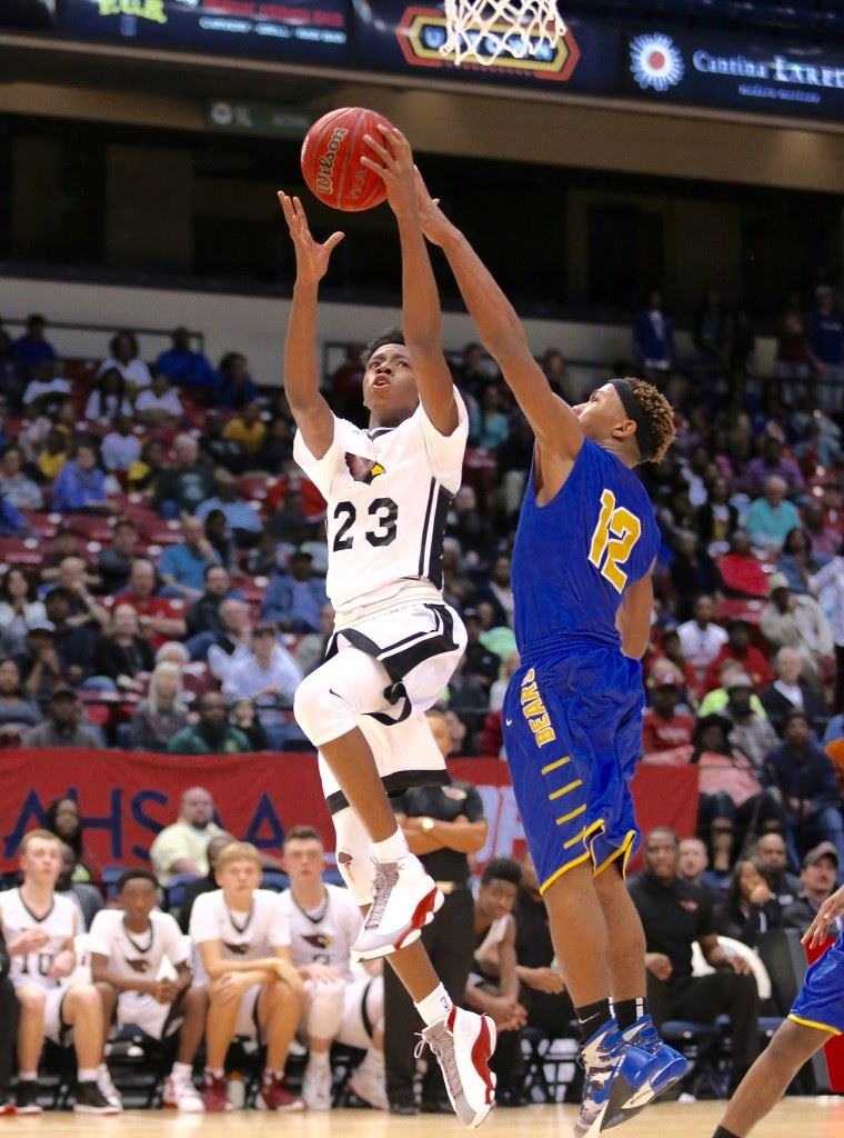 Kevion Nolan (23) goes around Keith's Justyn Pettway for two of his 20 second-half points in Friday's Class 1A state semifinal game. (Photos by Kristen Stringer/Krisp Pics Photography)