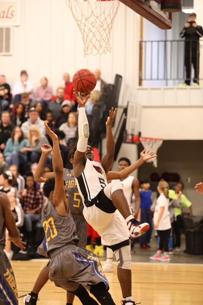 D.J. Heath tries to hold his balance while taking a shot against TCC Tuesday night. (Photo by Kristen Stringer/Krisp Pics Photography)