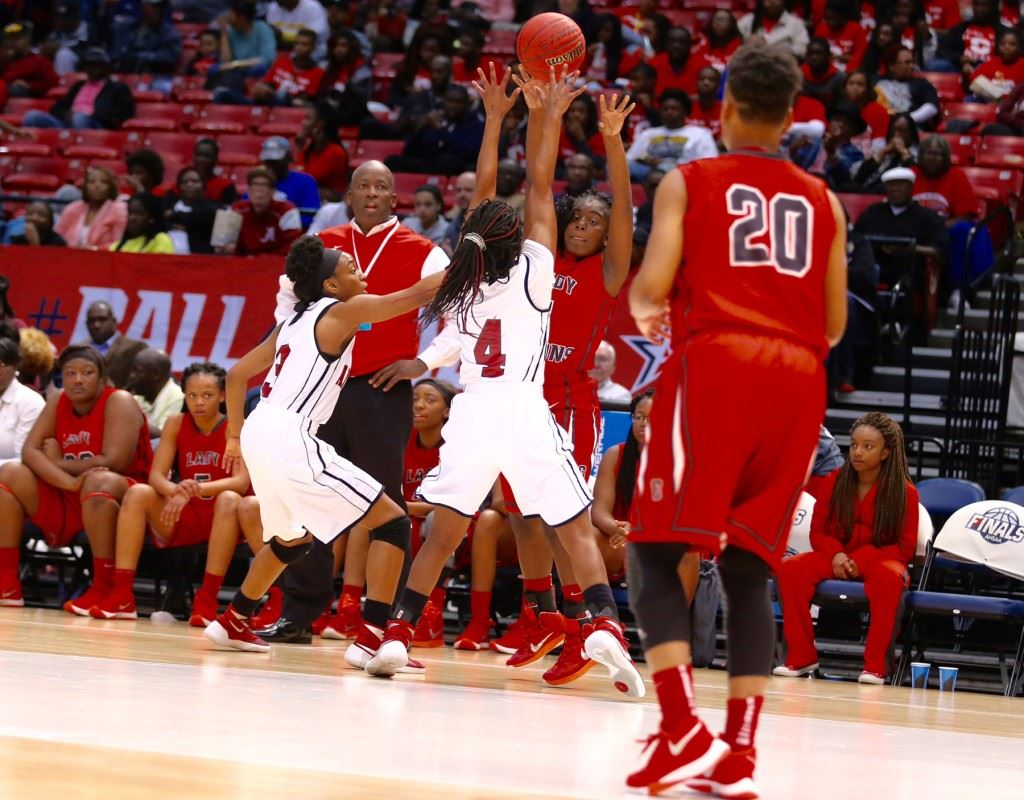 Raven Cooley (4) and Miajah Bullock (3) display the tight defense that got Anniston back in its Class 5A girls semifinal Wednesday. (Photo by Kristen Stringer/Krisp Pics Photography)