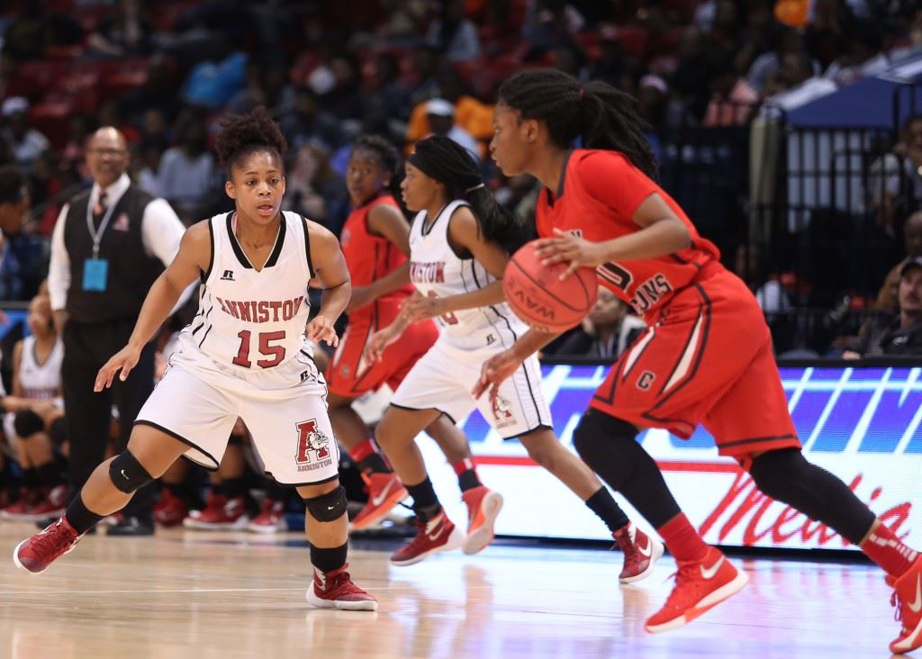 Anniston's Davia Palmer (15) moves in to defend against Central Tuscaloosa leading scorer Traniya Pitts. (Photo by Kristen Stringer/Krisp Pics Photography)