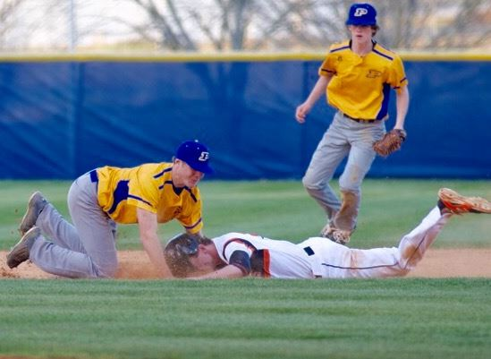 Piedmont shortstop Bayley Blanchard (L) does all he can to keep Alexandria's Riley Shaw from reaching the base on this attempted steal in the second inning Monday. Riley was out to end the inning. (Photo by B.J. Franklin)