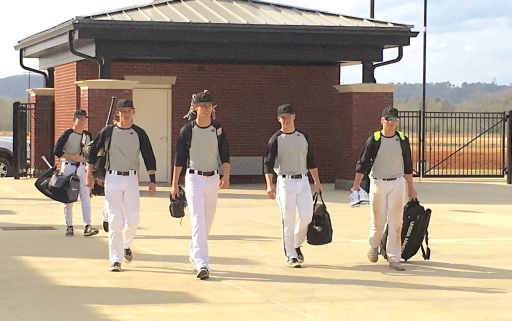 Oxford's earliest arriving players make their way into Choccolocco Park for their first practice on the signature baseball field.