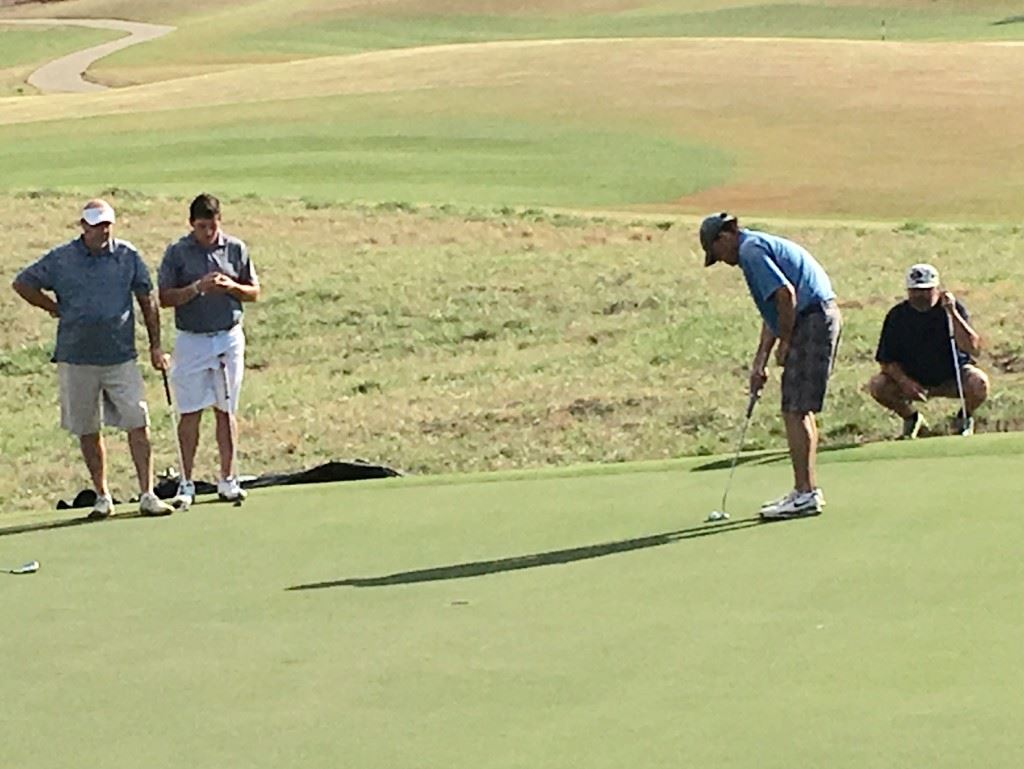 The teams of Ott and Dalton Chandler (left side) and Kevin Daugherty (putting) and Jeff Champion were chasing the leaders and battling for second the entire back nine Sunday. They were a combined 13-under-par on the back.