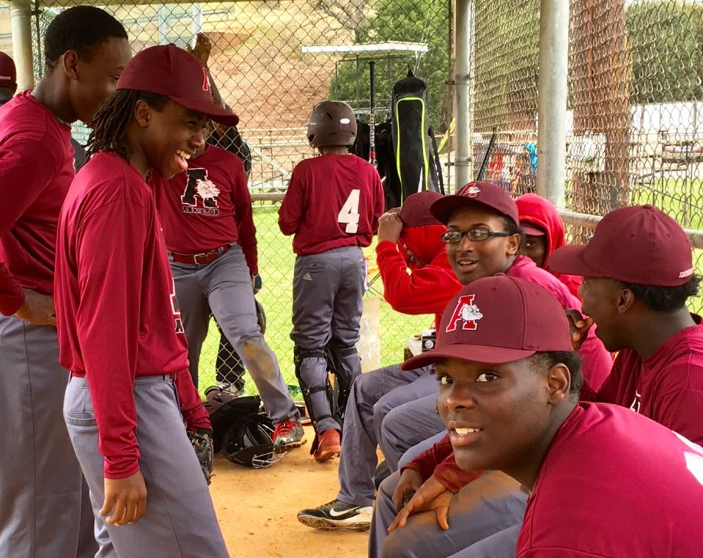 The Anniston dugout manages to keep a good attitude despite being down on the scoreboard. Tae Bush (in glasses) pitched two good innings before it got away from him in the third.