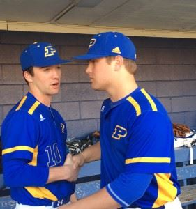 Closer Caleb Morrow (L) congratulates starter Taylor Hayes in the dugout after the Piedmont left-hander's strong start in Tuesday's area opener.