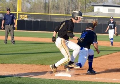 Oxford's Caden Higgins runs out a close play at first base against White Plains. Below, Jackets first baseman Brennan McCullough keeps Etowah's Cody Taylor close in the first inning of their nightcap. (Photos by B.J. Franklin/GungHo Photos)