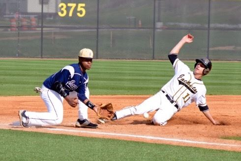 Jacob Sears (11) steals third ahead of the tag of Jacksonville's Tae Loud early in their game Saturday. (Photo by B.J. Franklin/GungHo Photos)