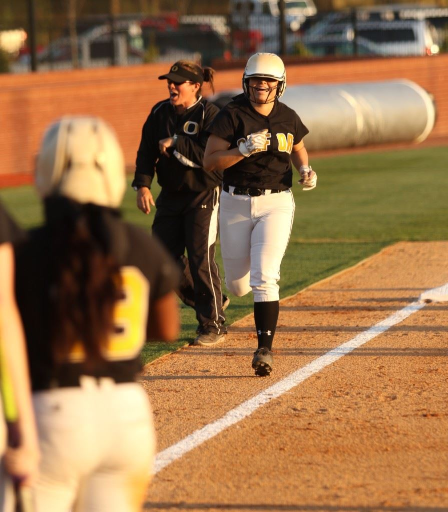 Grace Mitchell heads for home, where her teammates await, after hitting the go-ahead three-run homer in the sixth inning. It was the Lady Jackets' first homer in the new Choccolocco Park softball field. (Photo by Kristen Stringer/Krisp Pics Photography)