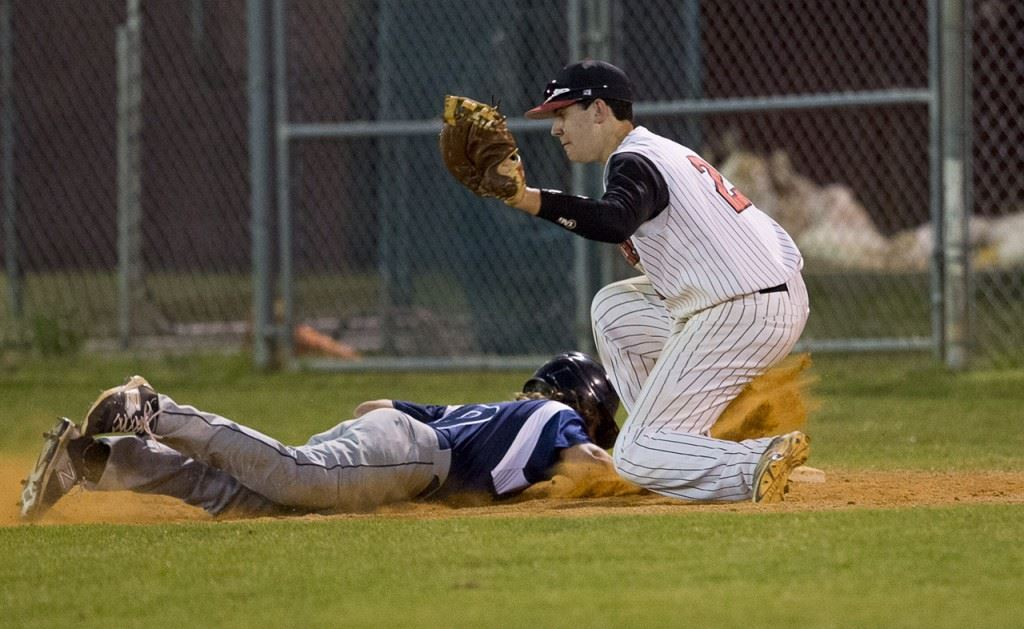 A Jacksonville runner gets back to the bag before Cleburne County first baseman Jordan Brown (2) can get down a tag. (Photo by Jonathan Fordham/J&E Art&Design)