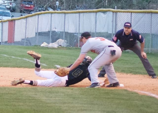 Oxford's Austin Bolander (8) slides back into first base ahead of the tag of Alexandria's Cody Dodd. Bolander scored three runs in the championship game and was named Offensive MVP of the tournament.