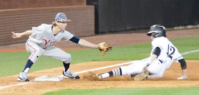Oxford's Carson Lindsey (12) tries to get to the bag before Clay Central third baseman Shea Cronin can lay down the tag. (Photo by B.J. Franklin)
