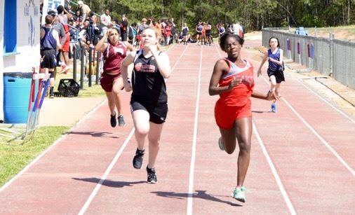 Saks' Lyndah Truss leads Weaver's Tabitha Roberts across the line during their 100-meter heat race Friday. (Photo by B.J. Franklin/GungHo Photos)