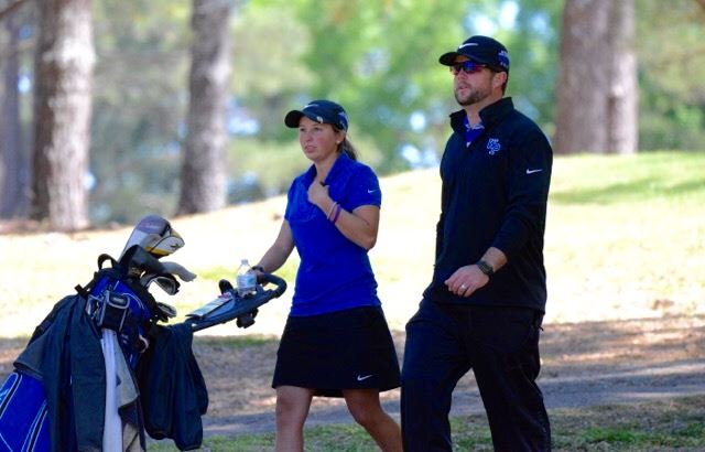 Tournament champion Layne Dyar and White Plains coach Marcus Harrell talk strategy between holes during Saturday's final round of the Calhoun County Girls Golf Championship. (Photo by B.J. Franklin/GungHo Photos)