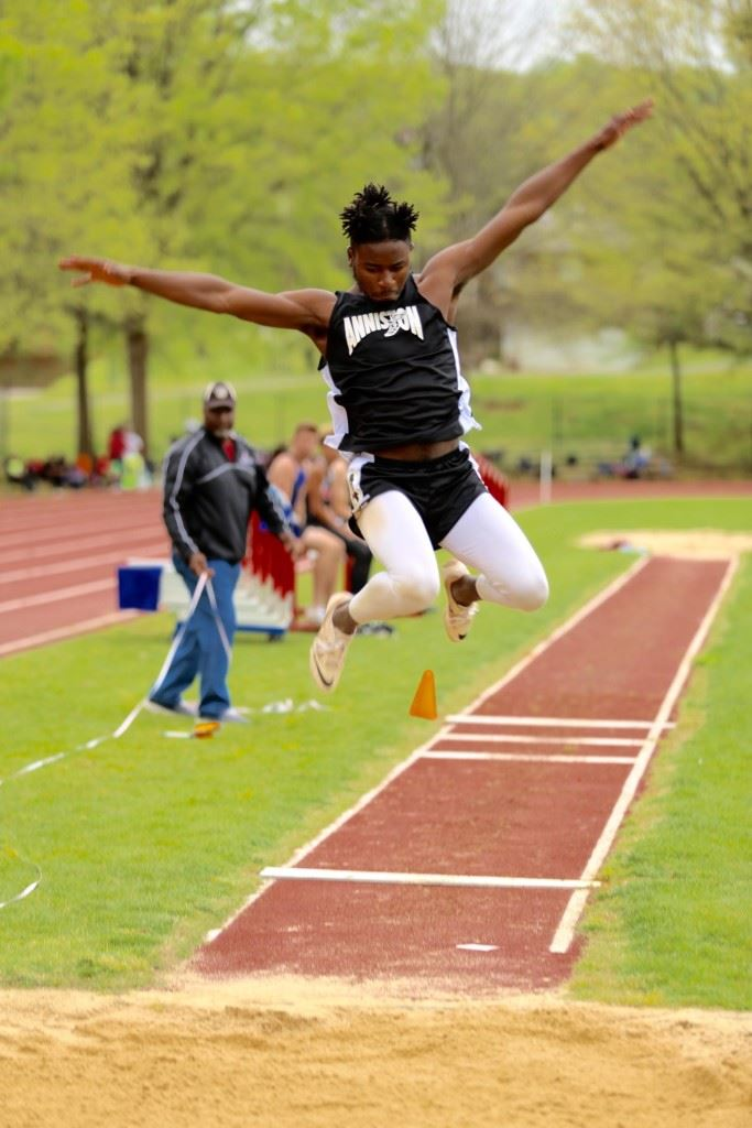 Anniston's Tae Miller won the long jump and the triple jump, setting the county long jump record on his first attempt of the day. (Photo by Kristen Stringer/Krisp Pics Photography)