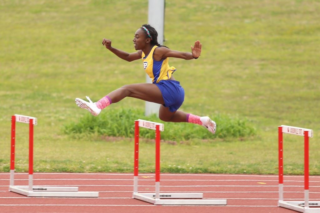 Piedmont's Karri Green won four events, including a record-shattering performance in the 100 hurdles. (Photo by Kristen Stringer/Krisp Pics Photography)