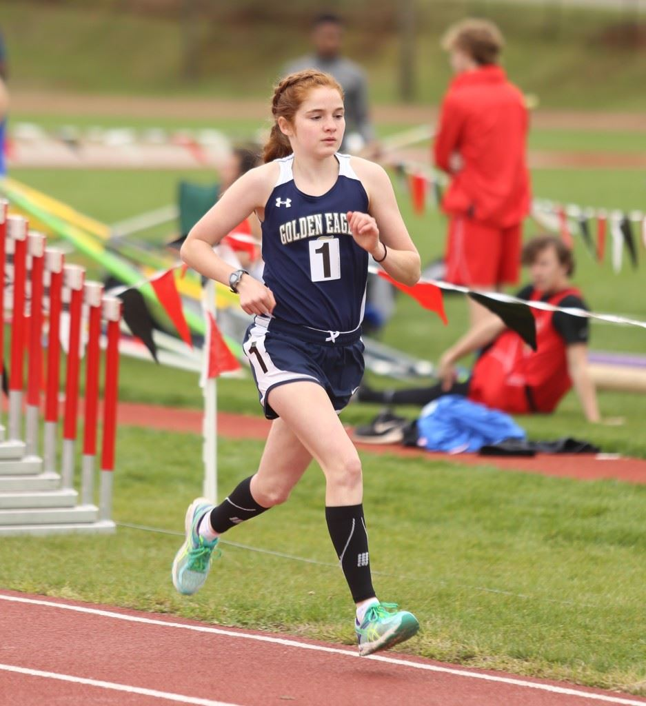 Jacksonville's Rebecca Hearn won the girls 1600 and 3200, setting the record in the 1600. (Photo by Kristen Stringer/Krisp Pics Photography)