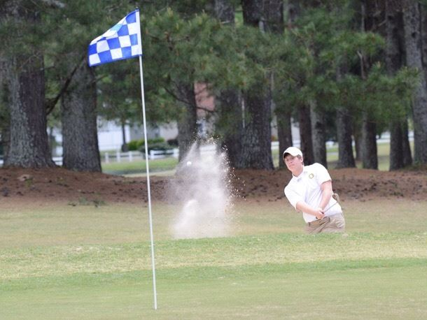 Oxford's Will Turley blasts out of the greenside bunker on 18 at Pine Hill CC Saturday. (Photos by B.J. Franklin/GungHo Photos)