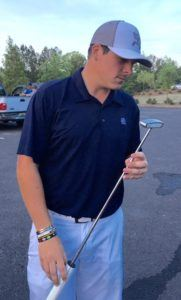 Tournament winner Dalton Chandler admires the borrowed putter that pulled him through in the Oxford City Championship.