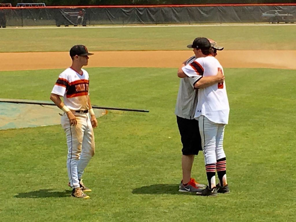 Alexandria pitcher Cody Dodd (R) gives/gets one last hug from his father Jimmy after pitching the Valley Cubs to a series sweep of Mortimer Jordan Saturday.