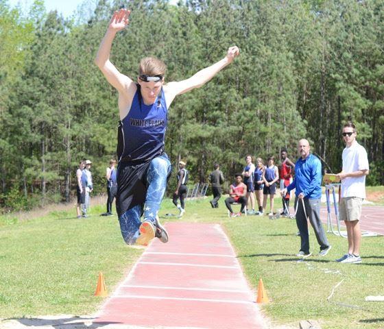 White Plains' Michael Singleton flies through the air during his triple jump Friday. (Photo by B.J. Franklin/GungHo Photos)