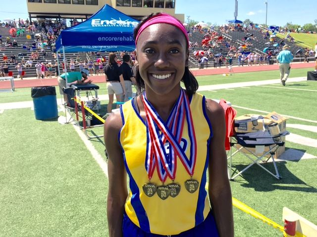 Piedmont senior Karri Green proudly displays the four gold medals she won at this year's Class 3A state championship meet.