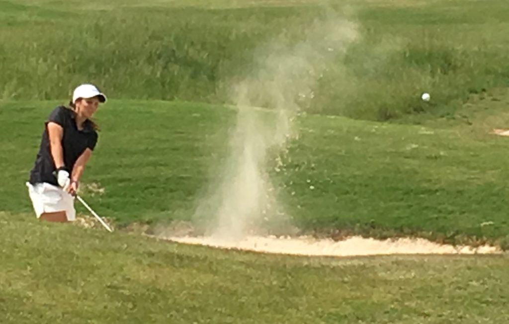 White Plains' Layne Dyar blasts out of the greenside bunker on Highlands No. 11.