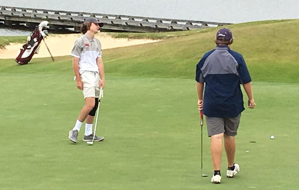 Donoho's Jack Svensen reacts to his putt during Monday's opening round of the AHSAA state tournament.
