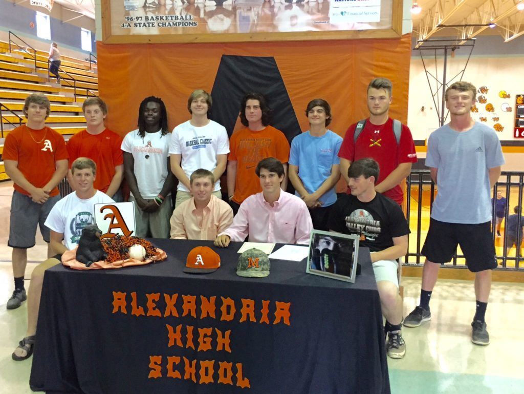 Alexandria's Will Reaves (front row, second from right) is joined by his Valley Cubs teammates at his signing ceremony with Marion Military Institute Wednesday.