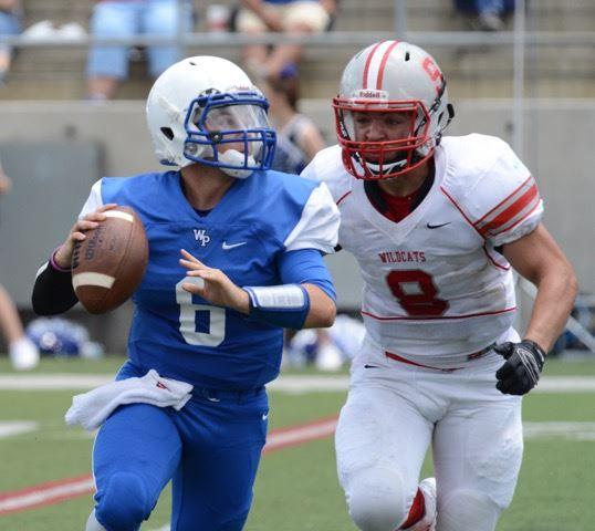 Saks' Will Fletcher gets a bead on White Plains' quarterback Thomas Roszell.