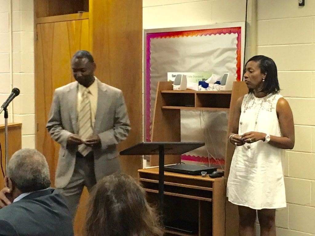 New Anniston basketball coach Torry Brown and his wife Deidra are introduced at the Anniston school board meeting Thursday night.