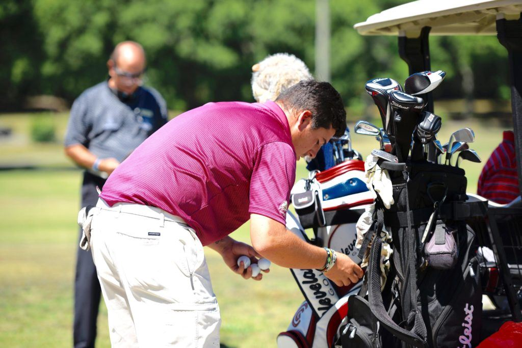 Defending amateur medalist Dalton Chandler checks his gear before stepping to the first tee Friday in the opening round of the Fort McClellan Credit Union Pro-Invitational. (Photo by Sandra Howell)