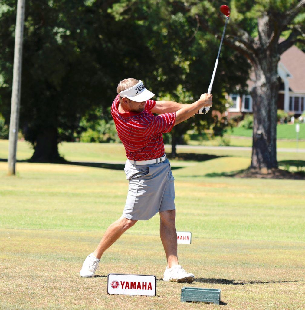 Caleb Bowen rips a drive down the first fairway to get his round started Friday. Bowen got off to a slow start but eagled 18 to shoot 72. (Photo by Sandra Howell)