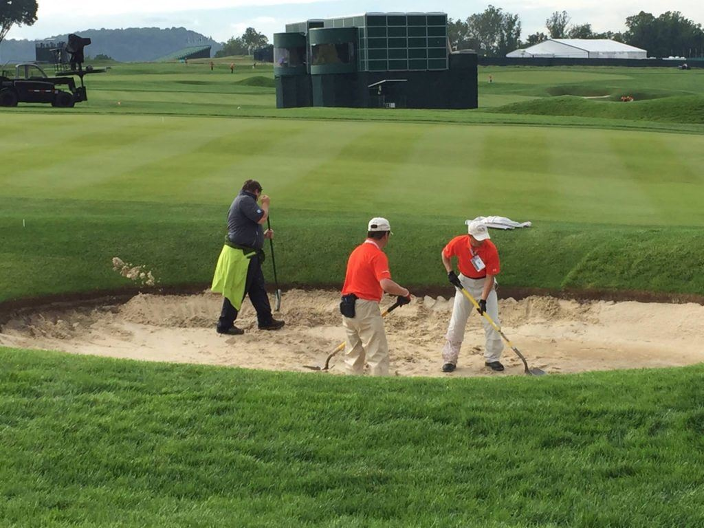 Crews work to restore Oakmont's bunkers after Thursday's heavy rains. On the cover, inside the ropes on No. 3. (Photos by Kenny Szuch via Facebook)