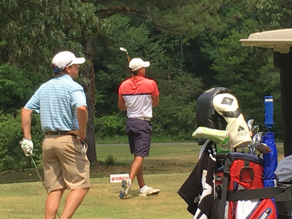 Tournament leader Jimmy Brandt (R) and Jared Davis follow the flight of Brandt's tee shot on 13 Saturday at Cane Creek. On the cover, amateur leader Ty Cole looks for a clear path to the green for his second shot on 18.