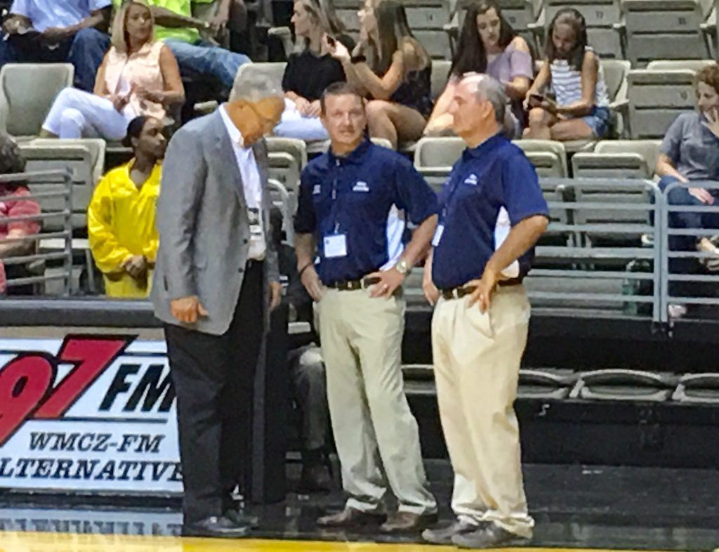 North coaches Chris Randall of White Plains (C) and Geraldine's Cale Black share a moment with AHSAA executive director Steve Savarese moments before the North-South boys basketball all-star game. On the cover, Faith Christian's Jordan Griswould (1) and Oxford's Jakolbe McClendon run through a drill in pre-game warmups.