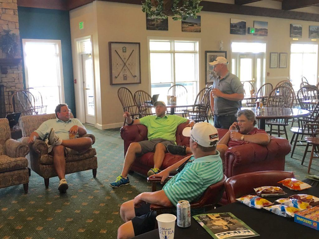 Players at Silver Lakes watch the scores come in from Friday's opening round of the Sunny King Charity Classic.
