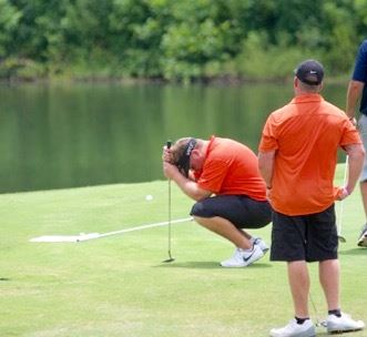 Benji Turley drops his head after a putt fails to drop Saturday at Cider Ridge.