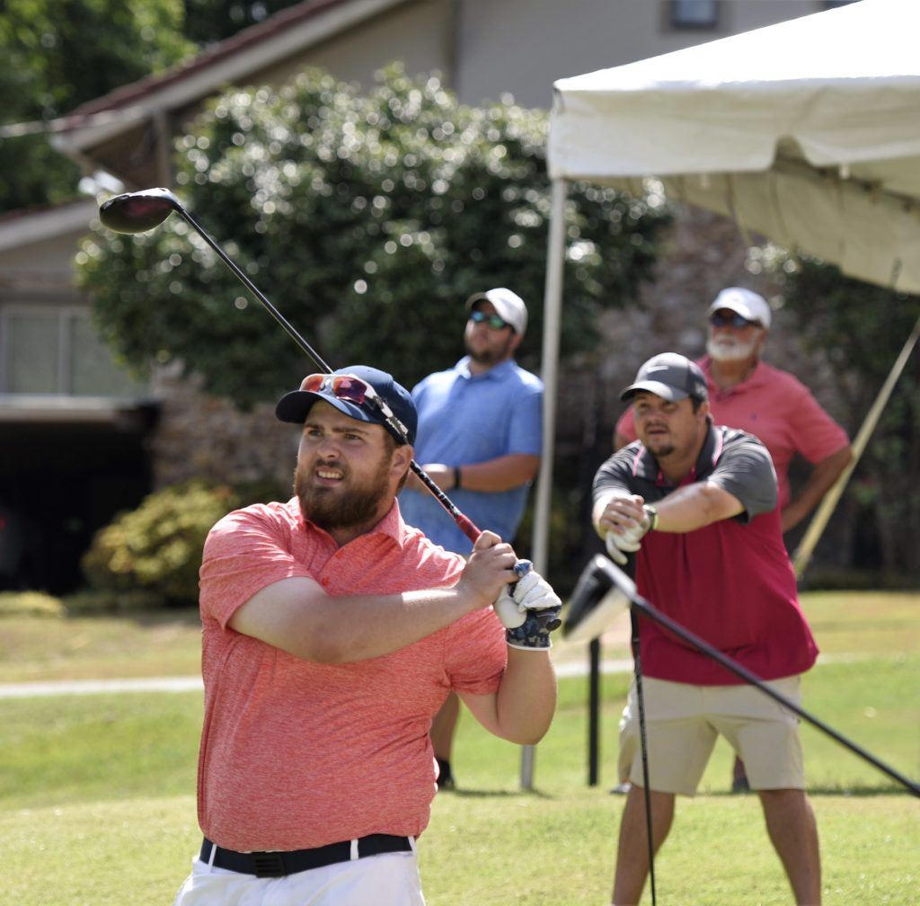 Caleb McKinney watches the flight of his drive on No. 17 at Anniston CC after nearly holing an ace on the par-3 16th. (Photo by Sandra Howell)