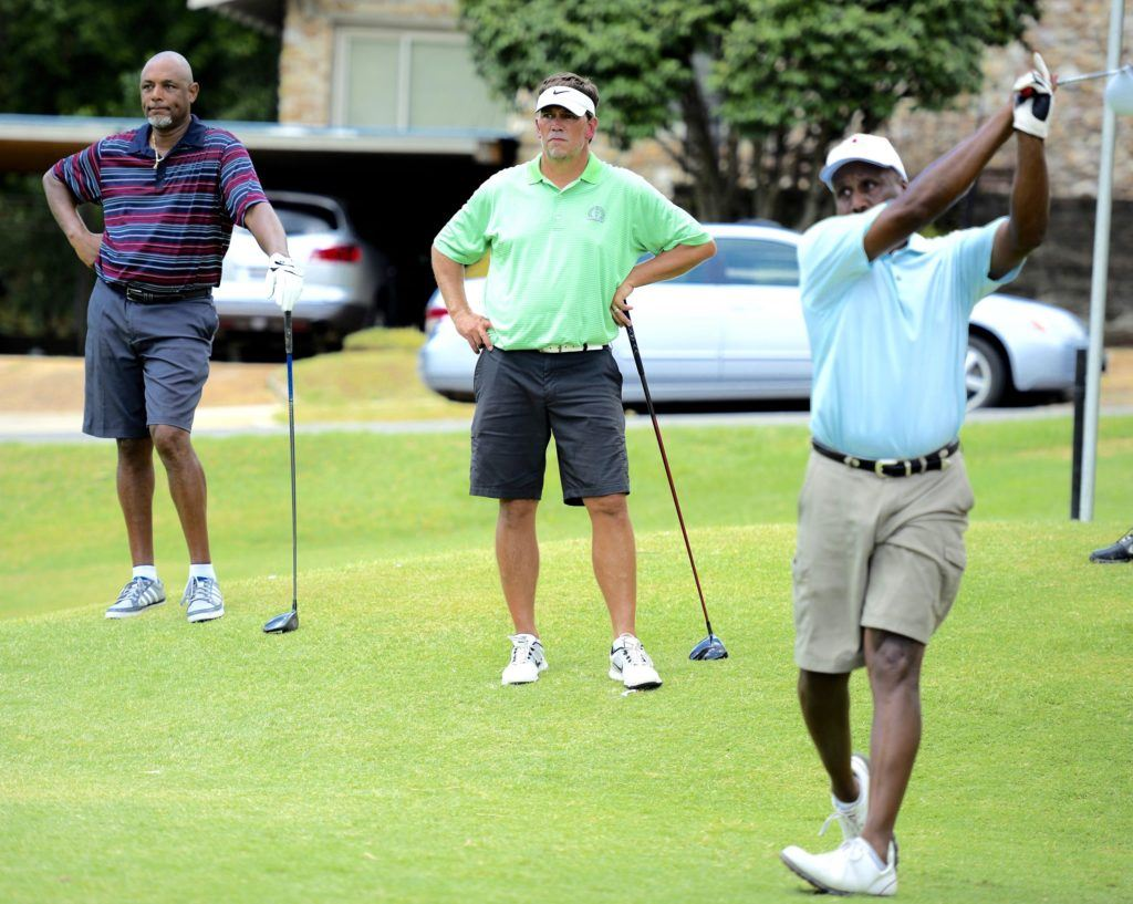Bernard Snow (L) and Mike Hughston (C) watch Eric Stringer drive off the 17th tee in first flight Acura MDX play at Anniston CC. (Photo by Sandra Howell)